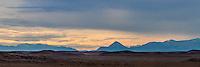 SILUETAS DE MONTANAS EN EL ATARDECER, CERCANIAS DE PERITO MORENO, PROVINCIA DEL CHUBUT, ARGENTINA (PHOTO © MARCO GUOLI - ALL RIGHTS RESERVED)