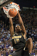 Missouri forward Marshall Brown slams the ball after a brake away in the first half against Kansas State.  K-State defeated the Tigers 79-64 at Bramlage Coliseum in Manhattan, Kansas, January 21, 2006.