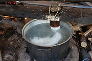 Rice mash is pressed to create rice noodles. Angkor Wat, Siem Reap, Cambodia.