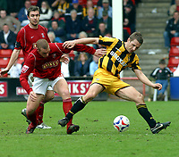 Photo: Dave Linney.<br />Walsall v Port Vale. Coca Cola League 1. 15/04/2006.<br />Walsall's (L) battles for the ball with  Michael Walsh