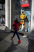 A passer-by walking past the fully kitted-out mannequin of a mountaineer in the window of outdoor equipment retailer The North Face on Regent Street, on 18th April 2017, in London, England.