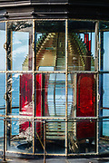 Red and clear Fresnel lens of the beacon at Cape Meares Lighthouse, built 1890. This Lightstation is now inactive. Cape Meares State Scenic Viewpoint, Oceanside, Oregon coast, USA.