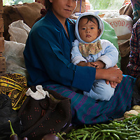Asia, Bhutan, Trongsa. Mother and baby at local market in Trongsa.
