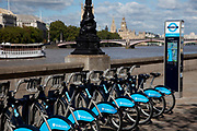 London cycle hire scheme bikes at Vauxhall, London. This docking station overlooks the Houses of Parliament.