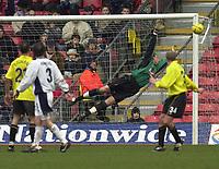 Photo. © Peter Spurrier/Sportsbeat Images<br /> 28/02/2004  -  Nationwide Div 1 Watford v Wimbledon<br /> Rob Gier shot goes past Watfords keeper Lenny Pidgeley  onlt to go wide.