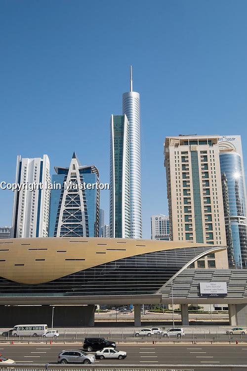 Metro station and skyscrapers at Jumeirah Lakes Towers (JLT) in Dubai United Arab Emirates