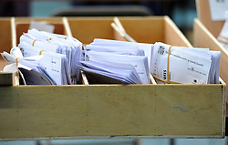 Verified ballot papers await collection during the local election count at Riverside Ice & Leisure Centre in Chelmsford, Essex.