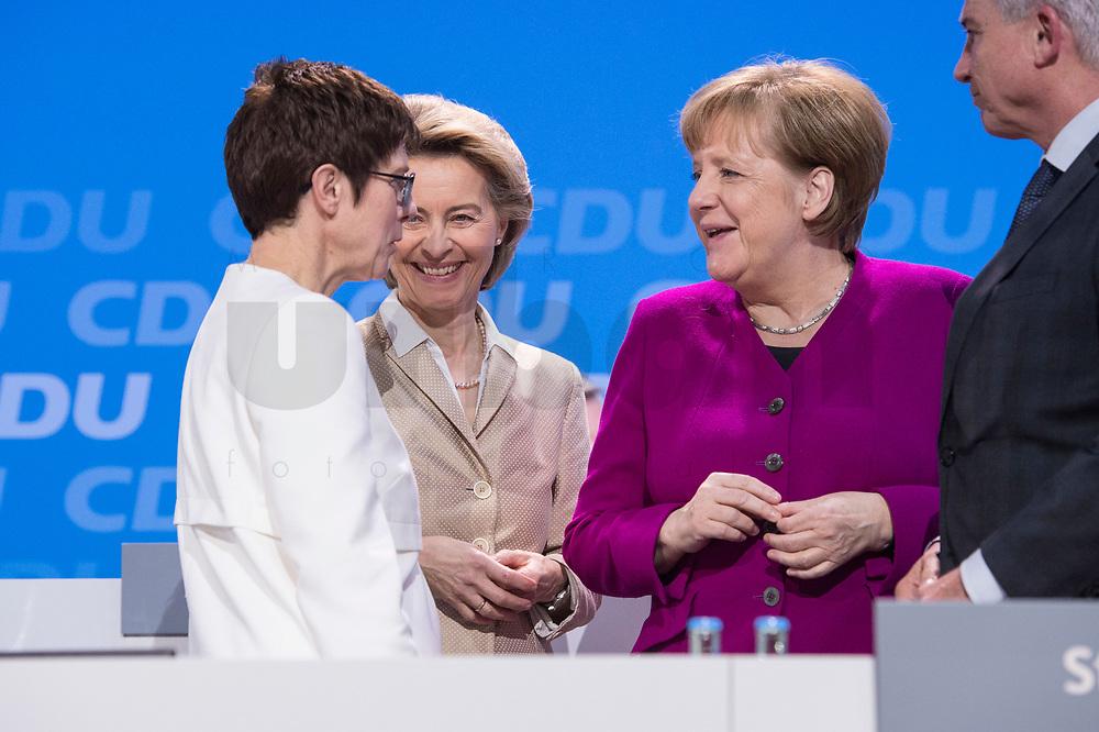 26 FEB 2018, BERLIN/GERMANY:<br /> Annegret Kramp-Karrenbauer (L), CDU, desig. Generalsekretaerin, Ursula von der Leyen (M), CDU, Bundesverteidigungsministerin, und Angela Merkel (R), CDU, Bundeskanzlerin, im Gespraech, CDU Bundesparteitag, Station Berlin<br /> IMAGE: 20180226-01-152<br /> KEYWORDS: Party Congress, Parteitag, Gespräch