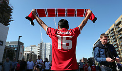 Manchester United fan holds up a scarf before the game during the Emirates FA Cup Final at Wembley Stadium, London.