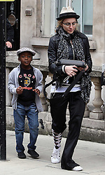 ©London News Pictures. 15/01/2011 .Picture Credit Should read Neil Hall/London News Pictures.Madonna directs her new period film W.E. starring Abbie Cornish about the abdication of King Edward in Londonon 08/08/2010 Pictured is Madonna with son David