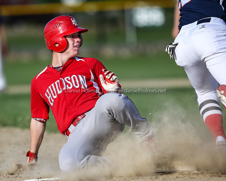 (6/16/14, HUDSON, MA) Hudson Post 100's Benjamin Palatino slides into third base safely during the American Legion baseball game against Ashland Post 77 at Hudson High School on Monday. Daily News and Wicked Local Photo/Dan Holmes