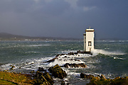The Lighthouse at Port Ellen, Islay. Photograph from the 8th December storm of 2011
