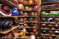 """Fabrizio Caoduro's """"70's Helmets"""" display at EICMA, the largest international motorcycle exhibition in the world. Milan, Italy. November 21, 2015.  Photography ©2015 Michael Lichter."""