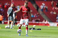Arsenal midfielder Aaron Ramsey (8) warms up before the Premier League match between Arsenal and West Ham United at the Emirates Stadium, London, England on 22 April 2018. Picture by Bennett Dean.
