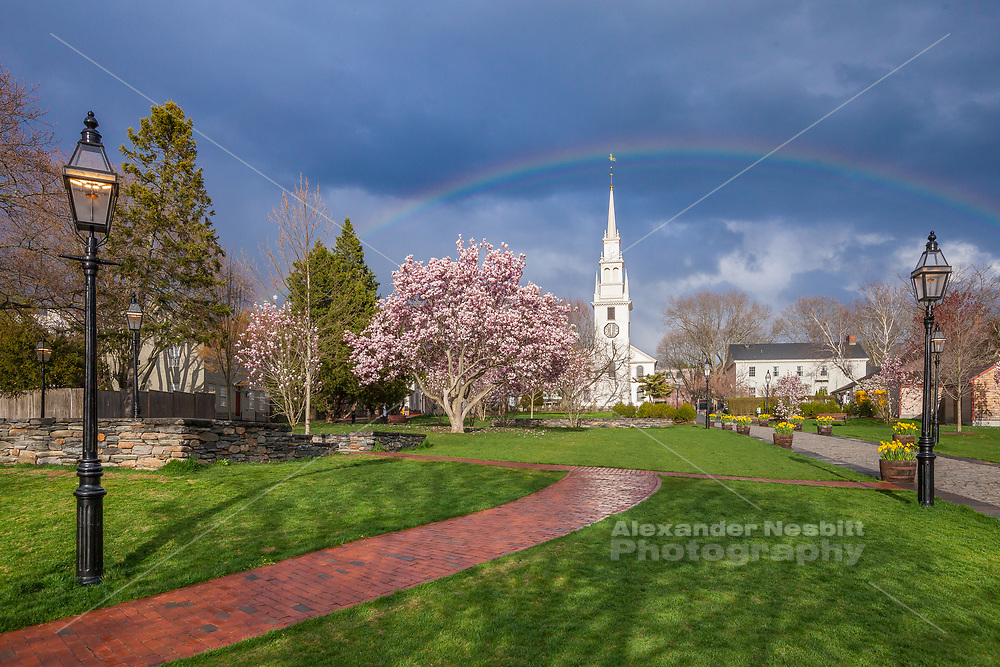 Newport RI. - Queen Anne Square in spring with a rainbow over Trinity Church