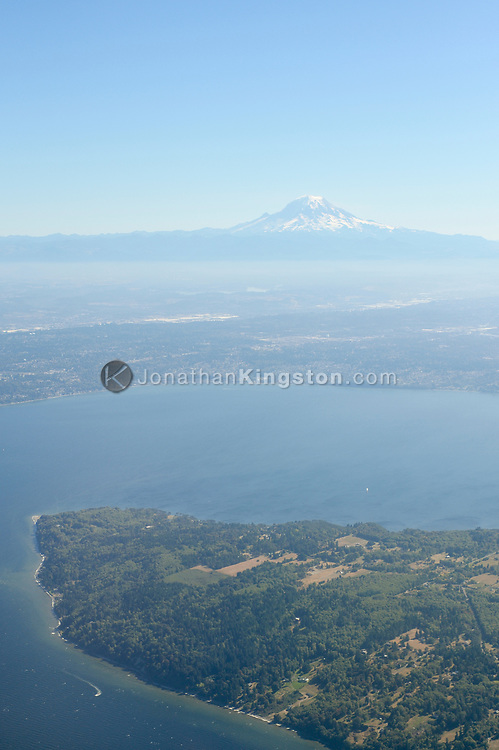 Aerial view of Mount Rainier rising above the city of Seattle Washington.