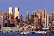 Skyline of New York City at dusk with skyscrapers of Midtown Manhattan including the Time Warner Center at left.