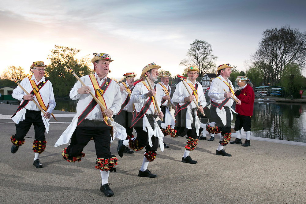 """© Licensed to London News Pictures. 01/05/2015. Stratford upon Avon, Warwickshire, UK. The Shakespeare Morris Men """"Dance in the Dawn"""" on the banks of the River Avon near the centre of Stratford upon Avon on the first day of May. Photo credit : Dave Warren/LNP"""