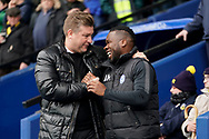 Oxford United manager Karl Robinson jokes with Aaron Maclean of Peterborough United during the EFL Sky Bet League 1 match between Oxford United and Peterborough United at the Kassam Stadium, Oxford, England on 16 February 2019.