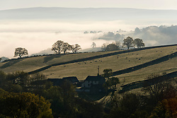 © Licensed to London News Pictures. 27/05/2021. Builth Wells, Powys, Wales, UK. Valleys are filled with mist near Builth Well in Powys after a very cold night with temperatures dropping to 1 deg C in parts of Powys. Photo credit: Graham M. Lawrence/LNP