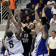 Anadolu Efes's Ermal KURTOGLU (C) during their Turkey Cup Qualifying basketball first match Anadolu Efes between Turk Telekom at Aliaga Arena in Izmir, Turkey, Sunday, October 9, 2011. Photo by TURKPIX
