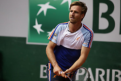 May 27, 2019 - Paris, France - Germany's Peter Gojowczyk returns the ball to France's Jo-Wilfried Tsonga during their men's singles first round match on day two of The Roland Garros 2019 French Open tennis tournament in Paris on May 27, 2019. (Credit Image: © Ibrahim Ezzat/NurPhoto via ZUMA Press)