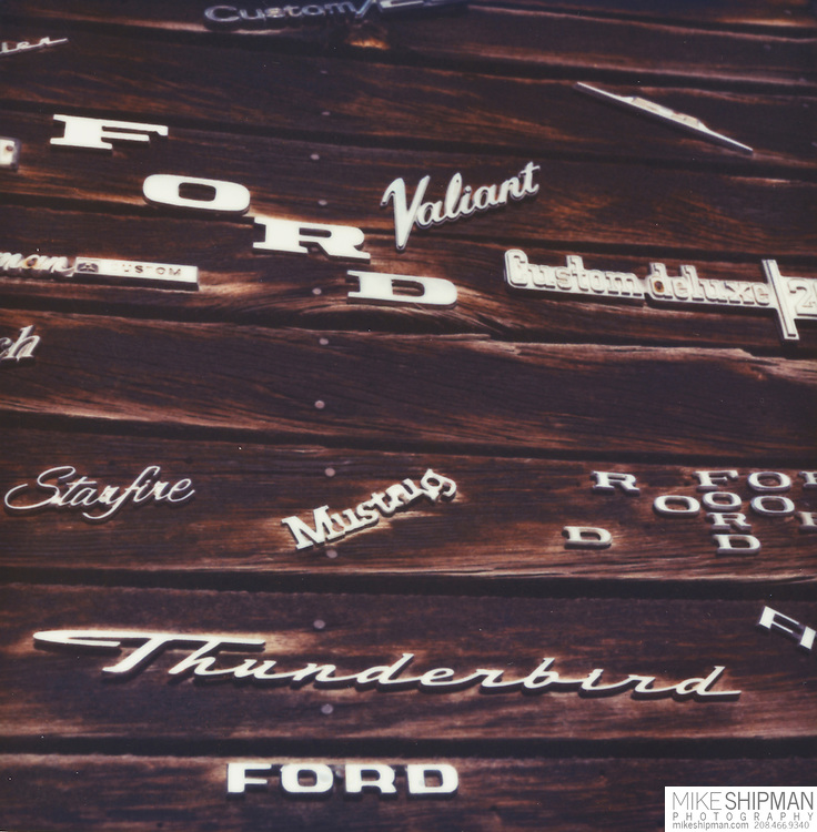 Automotive emblems adorn the old wood siding of an auto repair shop in Nampa, Idaho