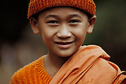 Young monk at a temple near Jinghong in Xishaungbanna, China.