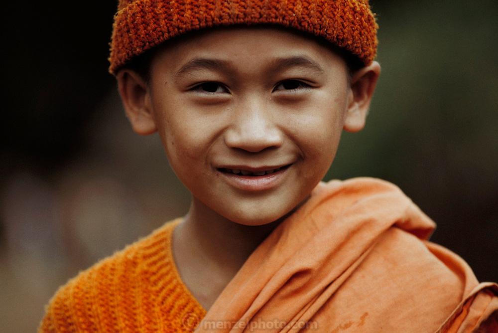 Young monk at a temple near Jinghong in Xishaungbanna, China.