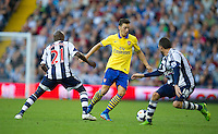 Arsenal's Mesut Ozil takes on West Bromwich Albion's Youssuf Mulumbu and Morgan Amalfitano<br /> <br /> Photo by Stephen White/CameraSport<br /> <br /> Football - Barclays Premiership - West Bromwich albion v Arsenal - Sunday 6th October 2013 - The Hawthorns - West Bromwich<br /> <br /> © CameraSport - 43 Linden Ave. Countesthorpe. Leicester. England. LE8 5PG - Tel: +44 (0) 116 277 4147 - admin@camerasport.com - www.camerasport.com