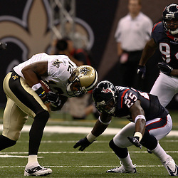 August 21, 2010; New Orleans, LA, USA; New Orleans Saints wide receiver Marques Colston (12) braces for a hit from Houston Texans defensive back Kareem Jackson (25) during the first quarter of a preseason game at the Louisiana Superdome. Mandatory Credit: Derick E. Hingle