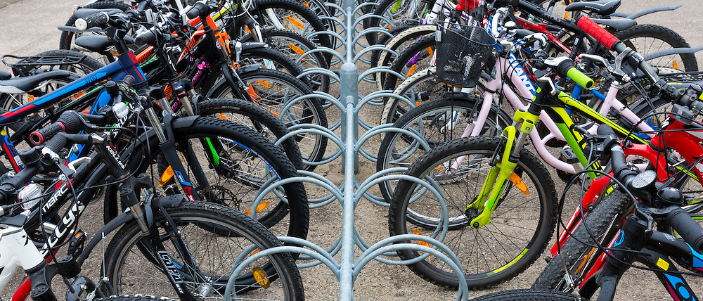 Cycles in a rack at a bike park at Ry in Denmark