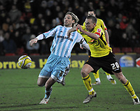 Photo: Richard Lane/Richard Lane Photography. Watford v Derby County. Coca Cola Championship. 12/12/2009. <br /> Robbie Savage of Derby and Tom Cleverley of Watford challenge for the ball