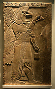 Eagle-headed protective spirit. Assyrian, about 865-860 BC From Nimrud, Temple of Ninurta