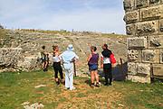 Tourists at the amphitheatre, Acinipo Roman town site Ronda la Vieja, Cadiz province, Spain