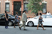 New York, NY- July 23: Family & Friends attend the funeral of Eric Garner, who fell victim to the tactics of the NYPD after NYPD Officers rendered him in chokehold on July 20, 2014 in Staten Island. His funeral was held on July 23, 2014 at Bethel Baptist Church in New York City.  (Terrence Jennings)