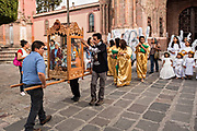 Local residents carry the statue of Saint Michael from the Parroquia de San Miguel Arcangel church at the start of the week long fiesta of the patron saint September 21, 2017 in San Miguel de Allende, Mexico.