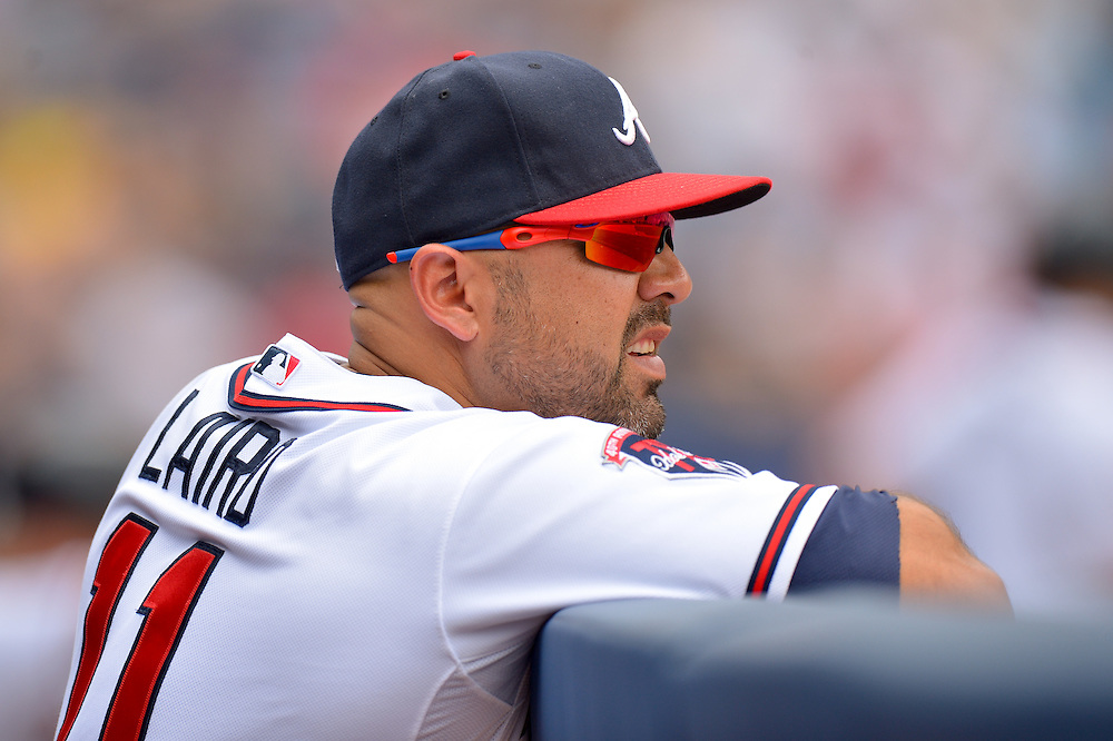 ATLANTA, GA - JUNE 18:  Gerald Laird #11 of the Atlanta Braves in the dugout against the Philadelphia Phillies at Turner Field on June 18, 2014 in Atlanta, Georgia. (Photo by Kevin Liles/Getty Images)  *** Local Caption *** Gerald Laird