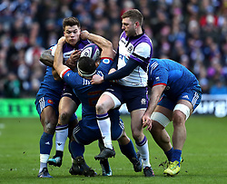 Scotland's Huw Jones (left) is tackled during the NatWest 6 Nations match at BT Murrayfield, Edinburgh. PRESS ASSOCIATION Photo. Picture date: Sunday February 11, 2018. See PA story RUGBYU Scotland. Photo credit should read: Andrew Milligan/PA Wire. RESTRICTIONS: Editorial use only, No commercial use without prior permission.