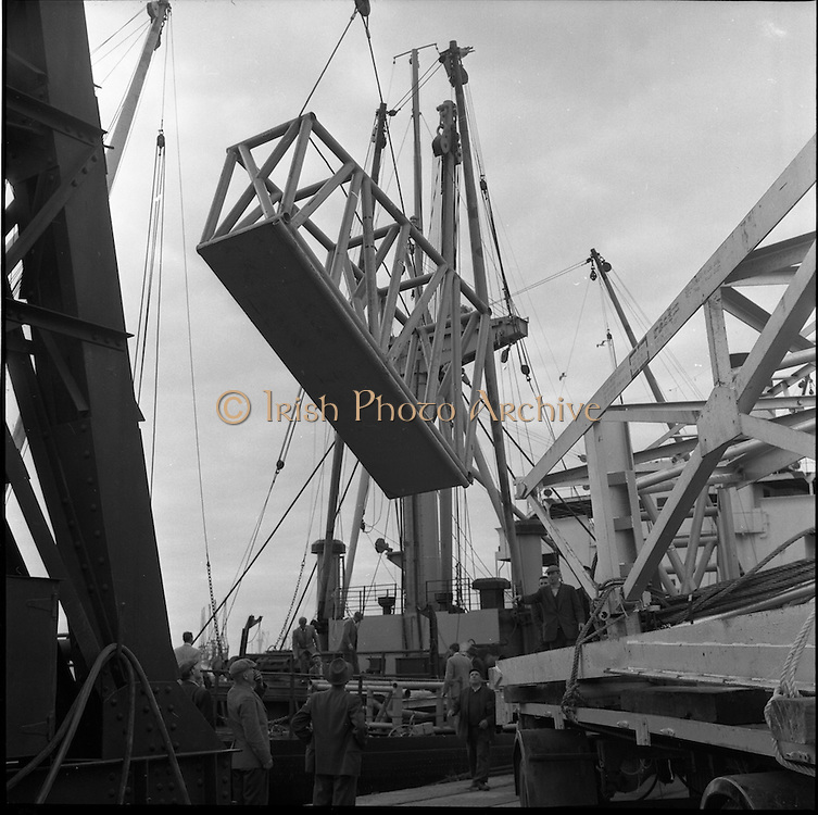 """31/07/1962<br /> 07/31/1962<br /> 31 July 1962<br /> Oil drilling equipment arrives at North Wall, Dublin. Image shows unloading of oil drilling machinery for Ambassador Irish oil from the ship """"Kendall""""."""
