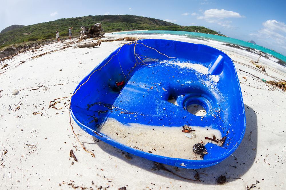 Discarded plastic garbage on a beach on tourist destination Lizard Island, Australia