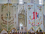 Puńsk- wieś położona wwojewództwie podlaskim, stolica kulturalna polskichLitwinów. Neogotycki Kościół Wniebowzięcia Najświętszej Maryi Panny wewnątrz którego znajdują się liczne chorągwie, rzeźby, witraże i ołtarze z  litewską ornamentyką.