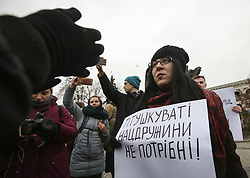 February 4, 2018 - Kiev, Ukraine - A woman holds a placard reading 'We don't need a mugger-like National Militia!' while people protest against the National Militia in  Kyiv, Ukraine February 4, 2018. (Credit Image: © Sergii Kharchenko/NurPhoto via ZUMA Press)