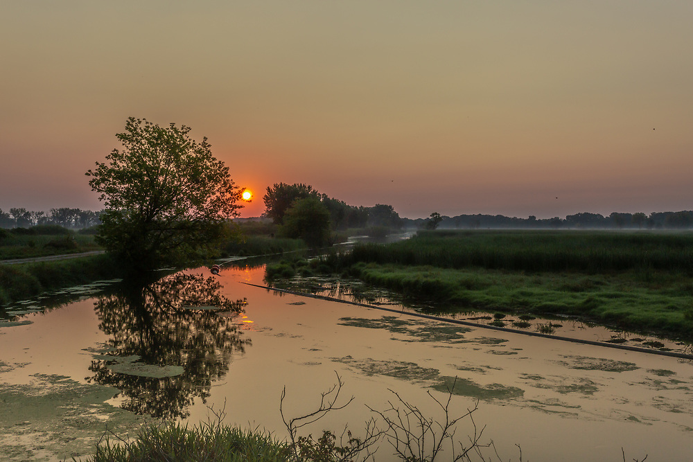 Hazy sunrise photographed from the Nine Springs E-Way Observation Deck, Madison, Wisconsin, Aug. 24,2020.