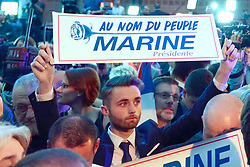 Supporters attend far-right National Front leader Marine Le Pen's celebration meeting at the Espace Francois Mitterrand on April 23, 2017, in Henin-Beaumont, north of France. Le Pen will face centrist leader Emmanuel Macron in a run-off for the French presidency on 7 May, near-final results show. With 96% of votes counted from Sunday's first round, Mr Macron has 23.9% with Ms Le Pen on 21.4%. Photo by Aurore Marechal/ABACAPRESS.COM