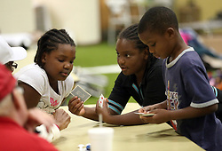 From left, Harmony Murphy, Selah Murphy and Craig Murphy from Rockport play a card game as they stay at the FEMA Dome after Hurricane Harvey displaced them, on Wednesday, August 30, 2017, at Tulsa-Midway High School in Corpus Christi, Texas, USA. Photo by Gabe Hernandez/Corpus Christi Caller-Times/TNS/ABACAPRESS.COM