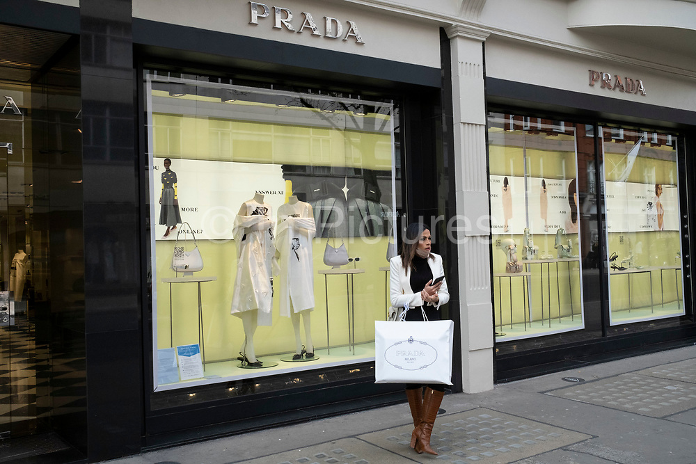 Shopping in the upmarket area of Knightsbridge on 14th April 2021 in London, United Kingdom. Knightsbridge is one of the principal areas for exclusive, luxury goods in West London. It is known as a district where the rich and wealthy shop, mostly for high end fashion and jewellery.