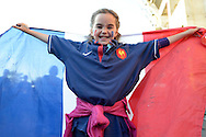 a Young French girl holding up the France flag outside Twickenham before k/o.Rugby World Cup 2015 pool D match, France v Italy at Twickenham Stadium in London on Saturday 19th September 2015.<br /> pic by John Patrick Fletcher, Andrew Orchard sports photography.