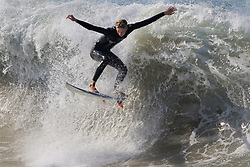 July 6, 2018 - Newport Beach, California, U.S. - At a surf sport known as 'the Wedge,' a surfer takes advantage of the cool water and big waves hitting Southern California. Record-breaking temperatures are hitting Southern California Friday. (Credit Image: © Charlie Neuman via ZUMA Wire)
