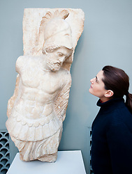 Woman looks at marble statue at The Ny Carlsberg Glyptotek art museum in Copenhagen Denmark